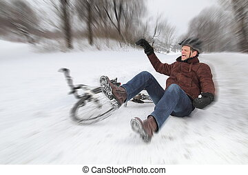 Bicycle accident in winter with a falling man