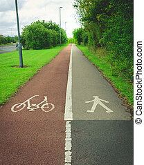 Bicycle and pedestrian sign painted on the road asphalt