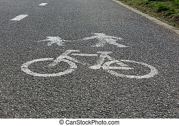 Bicycle and pedestrians road sign on asphalt.