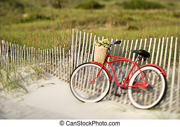 Bicycle at beach. - Red vintage bicycle with basket and...