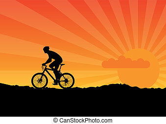 Bicycle - Black silhouette of bicicle on the orange sky.