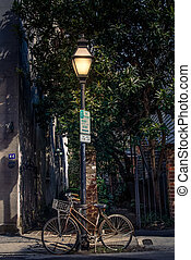 Bicycle Chained to Black Lamp Post