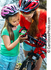 Bicycle compass in hands. Cyclist looking for way. - Bicycle...