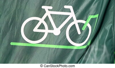 Bicycle Flag Waving - A green background banner flag with an...