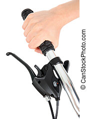 Bicycle handlebar - Hand holding bicycle handlebar, isolated...