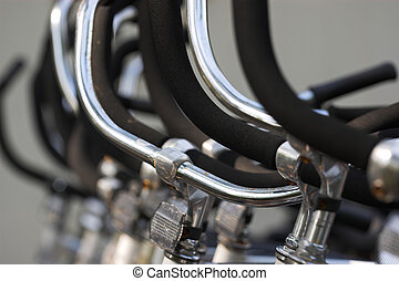 handlebars - bicycle handlebars in a row, shallow focus