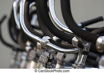 handlebars - bicycle handlebars in a row, shallow focus