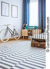 Bicycle in teenager's bedroom interior