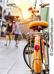 Bicycle in the city with sunlight