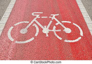 Bicycle lane sign on red asphalt
