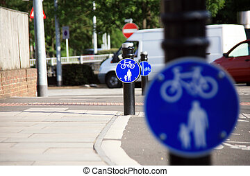 Bicycle lane with white mark of bicycle sign, London.