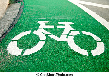 Empty green cycle track with bike lane sign