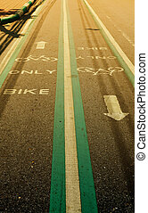 Bicycle lane on asphalt road, vintage filter effect