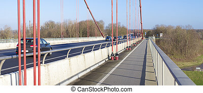 bicycle lane on suspension bridge - bicycle path on the red...