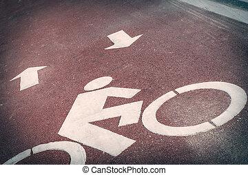 Bicycle lane or path, icon symbol on red asphalt road