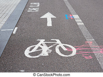 bicycle lane sign in a city and other road signs