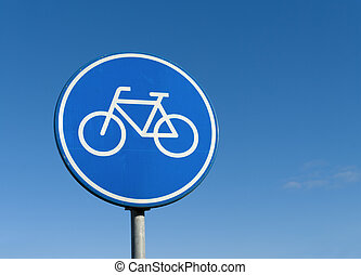 bicycle lane sign - round bicycle lane sign against a blue...