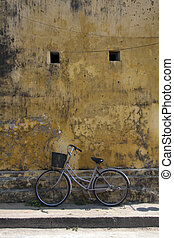 Bicycle leaning against a wall, Hoi An, Vietnam
