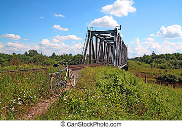 bicycle near railway bridge