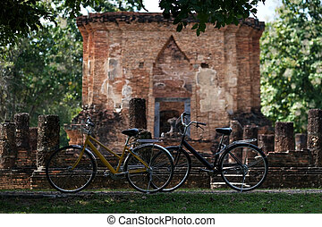 bicycle near the wall of old temple in Sukhothai, Old Town.