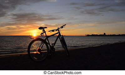 Bicycle on the coast at sunset