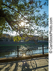 Bicycle on the embankment of river