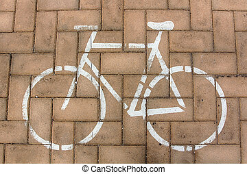 bicycle painted on the ground as a sign of bike lanes