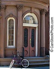 Bicycle parked near building entrance. Charleston, South Carolina, USA.