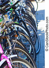 Bicycle parking area with group of colorful bicycles parked together