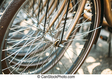 Bicycle Parking In European City. Close up of wheel