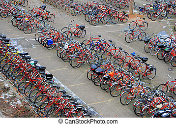 Many bicycles on a parking lot