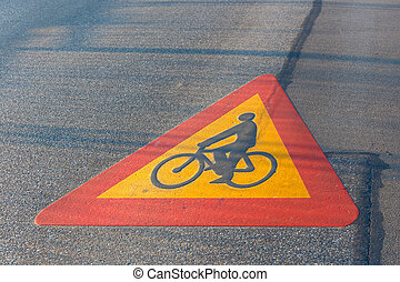 Bicycle path drawn on the asphalt road