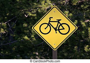 bicycle path sign with blurred forest background