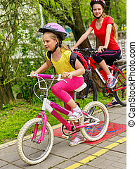Bicycle path sign with children. Girls wearing helmet with ...