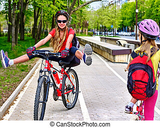 Bicycle path sign with children. Girls wearing helmet with rucksack .
