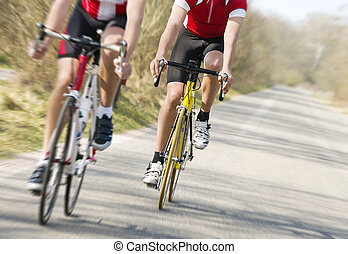 Bicycle race - Two cyclists on road racing bicycles in ...