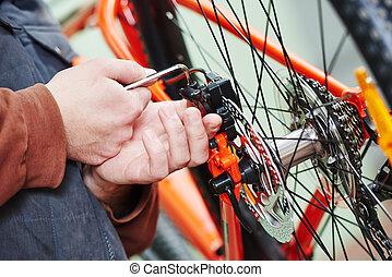 bicycle repair or adjustment - Mechanic serviceman repairman...