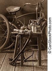 Bicycle repair workshop with tools, wheels and tube
