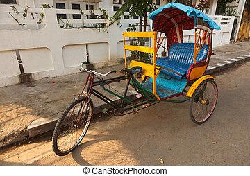 Empty bicycle rickshaw in street. Pondicherry, South India