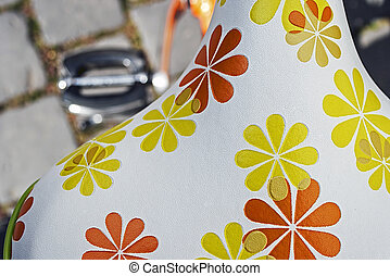 Bicycle saddle with floral pattern