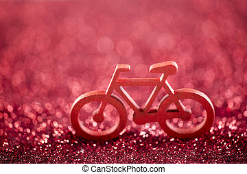 Bicycle shape on red glitter background