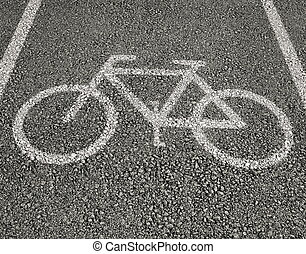 Bicycle sign close up on asphalt