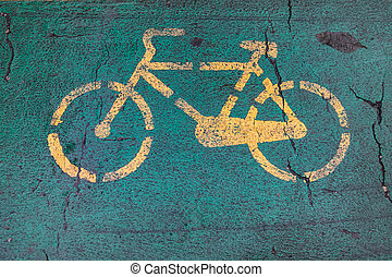 Bicycle sign on asphalt