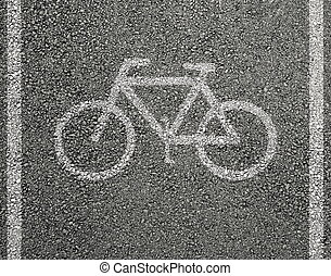Bicycle sign on asphalt
