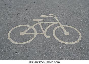 Bicycle sign on asphalt road