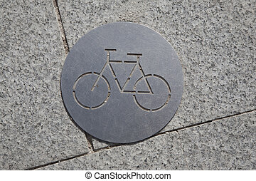 Bicycle Sign on Pavement in Urban Setting