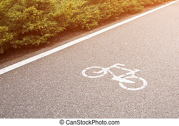 Bicycle sign on the road. Bike lane in the park