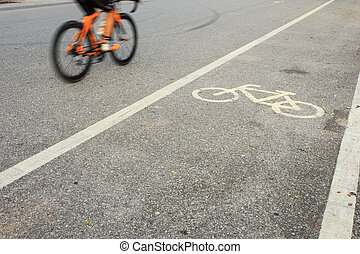 Bicycle sign or icon and movement of cyclist in the park