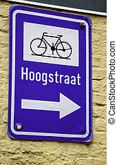 Bicycle sign with arrow