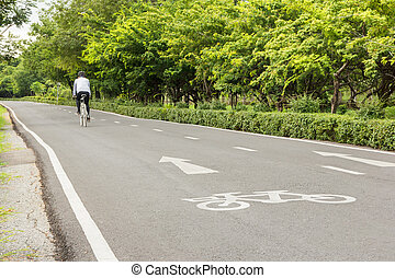 bicycle sign with cyclist on bicycle lane in the park